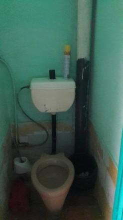 Продам коммуналку на ХБК  -кирпичный дом  -12кв.м  -чистая кухня  -душ  -с ремон. ХБК, Херсон, Херсонская область. фото 6