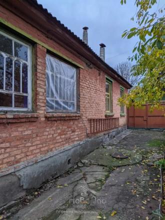 1/2  часть жилого дома площадью 116 кв. м с хозяйственными постройками (гараж, с. Лесковица, Чернигов, Черниговская область. фото 4