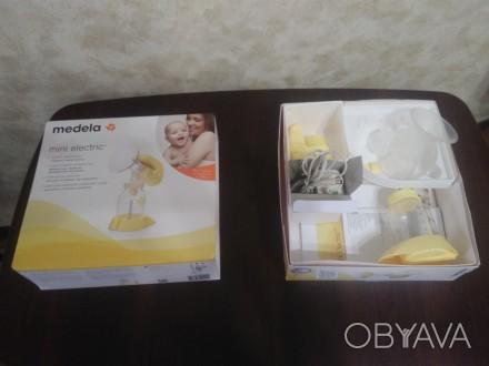 ПРОДАМ молокоотсос (молокосборник) medela mini electric™ (медэла мини электрик) . Сумы, Сумская область. фото 1