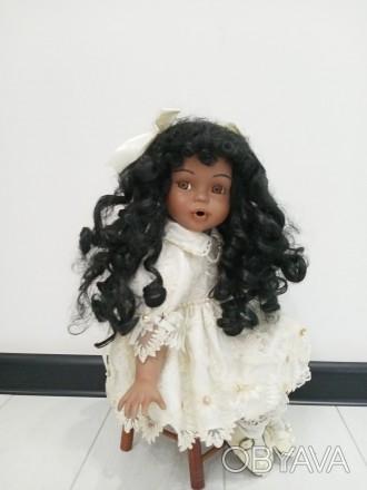Коллекционая фарфоровая кукла.