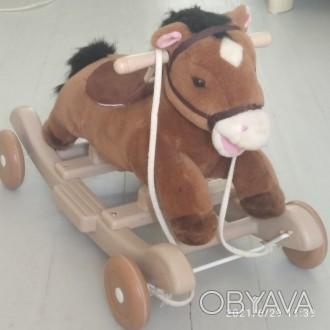 Многофункциональная лошадка-качалка с колесиками станет любимицей вашего крохи. . Киев, Киевская область. фото 1